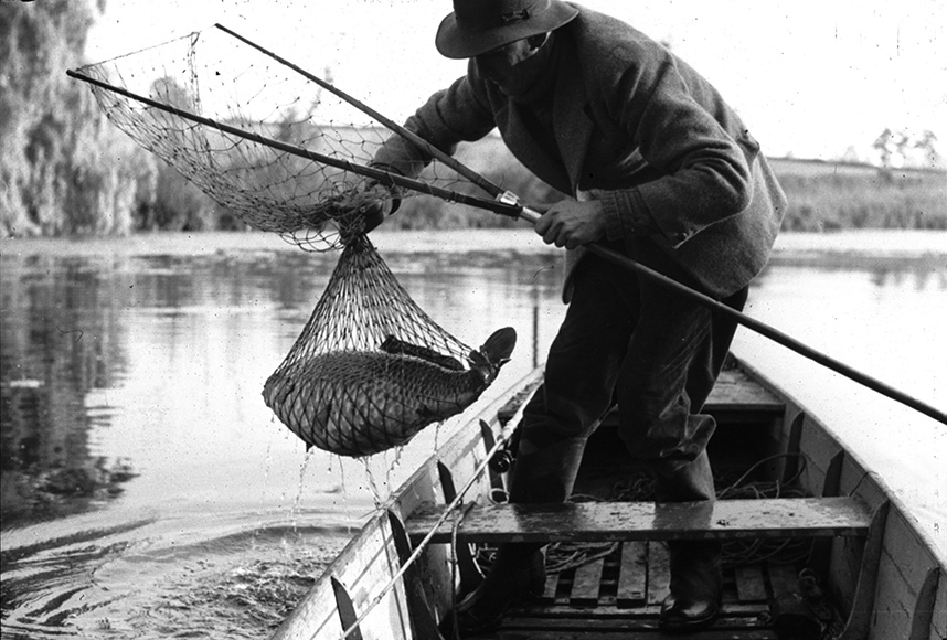 Dick Walker hauls his catch on board the famous Redmire punt