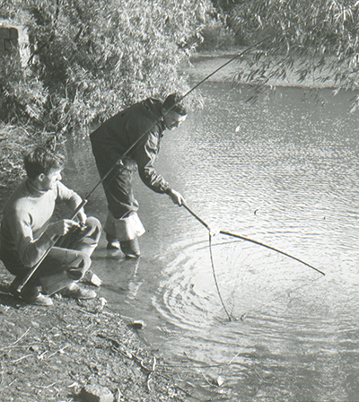 Pete landing a fish with Maurice Ingham netting